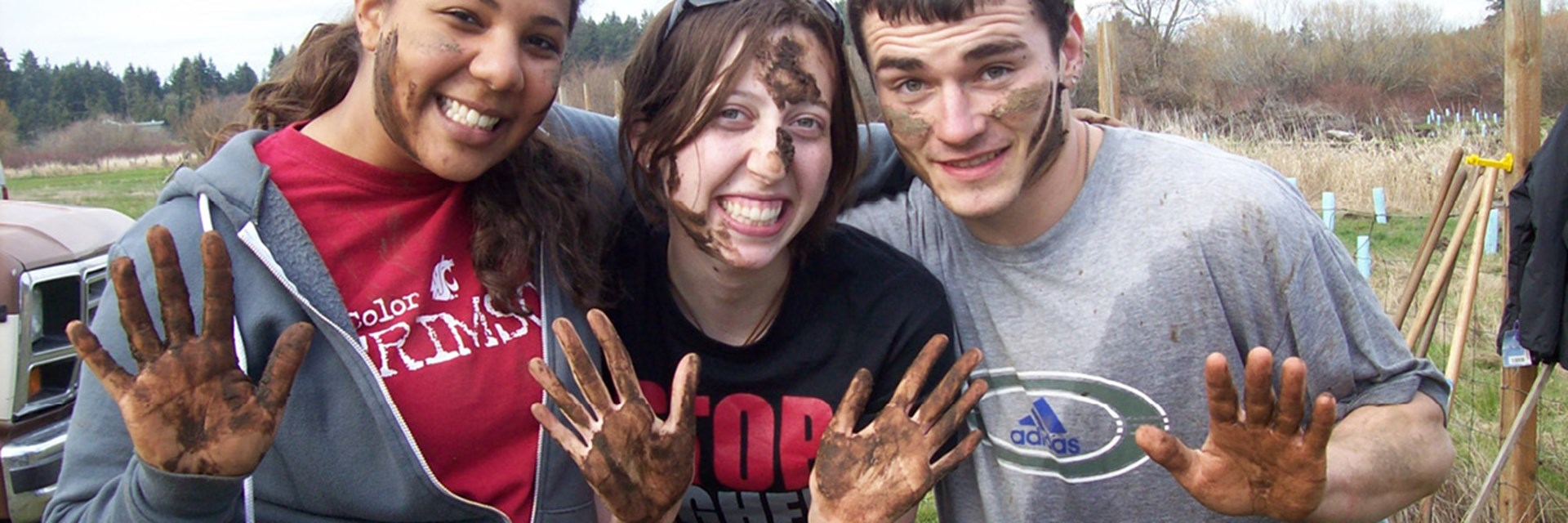 Students with muddy hands